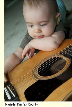 image of Baby playing guitar